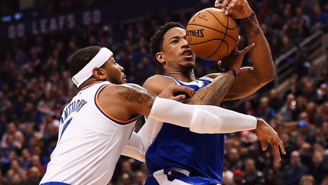 Toronto Raptors guard DeMar DeRozan (10) drives against New York Knicks forward Carmelo Anthony (7) during the first half NBA basketball game in Toronto on Saturday, Nov. 12, 2016.
