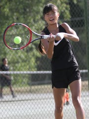 Gracie Pfieffer two-fists a return in Wednesday's girls 12 finale against Kaydence Hines in the 83rd News Journal/Richland Bank Tennis Tournament. Pfieffer prevailed 6-0, 6-0 for her third straight title in that division over Hines.