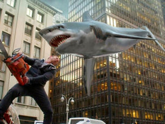 "In this image released by Syfy, Ian Ziering, as Fin Shepard, battles a shark on a New York City street in a scene from ""Sharknado 2: The Second One,"" which debuted in 2014."