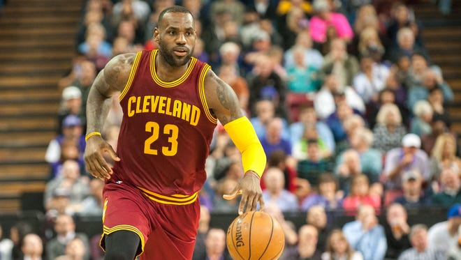 Cleveland Cavaliers forward LeBron James (23) pushes the ball up the court against the Sacramento Kings during the second quarter at Sleep Train Arena. The Cavaliers defeated the Kings 120-111.
