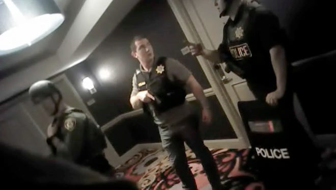 This photo from police officer body camera footage on Oct. 1, 2017, provided by the Las Vegas Metropolitan Police Department, shows officers searching hallways during the deadliest mass shooting in modern U.S. history by Stephen Paddock, at the Mandalay Bay Hotel in Las Vegas, released Wednesday, May 2, 2018.