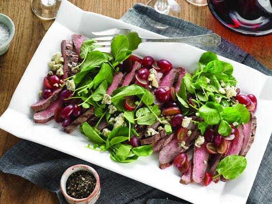 Grilled flank steak with grapes and Stilton cheese