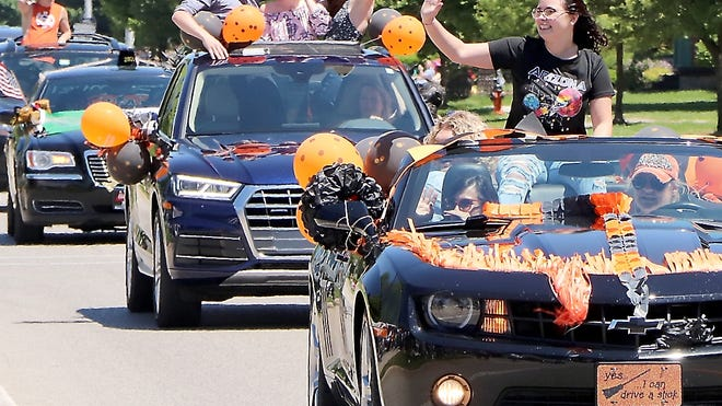 Sitting on or in vehicles decorated in school colors, the class of 2020 seniors waved to the hundreds who turned out to wish them well during the parade, held Sunday.