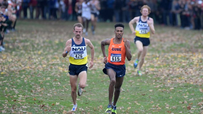 Northern Arizona's Matt Baxter and Tyler Day finished second and third at the NCAA Cross Country Championships, leading NAU to a second straight men's team title Saturday.