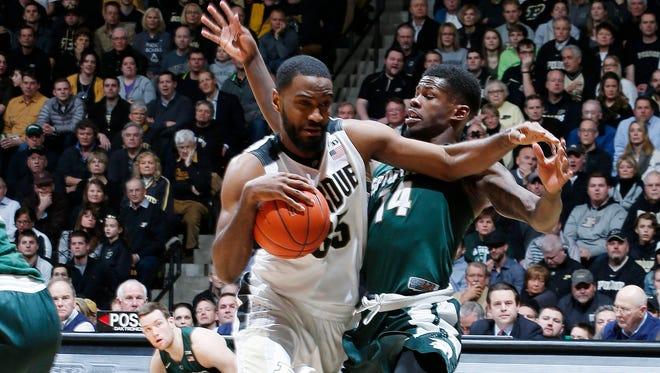Purdue Boilermakers guard Rapheal Davis (35) drives to the basket against Michigan State Spartans guard Eron Harris (14) at Mackey Arena.