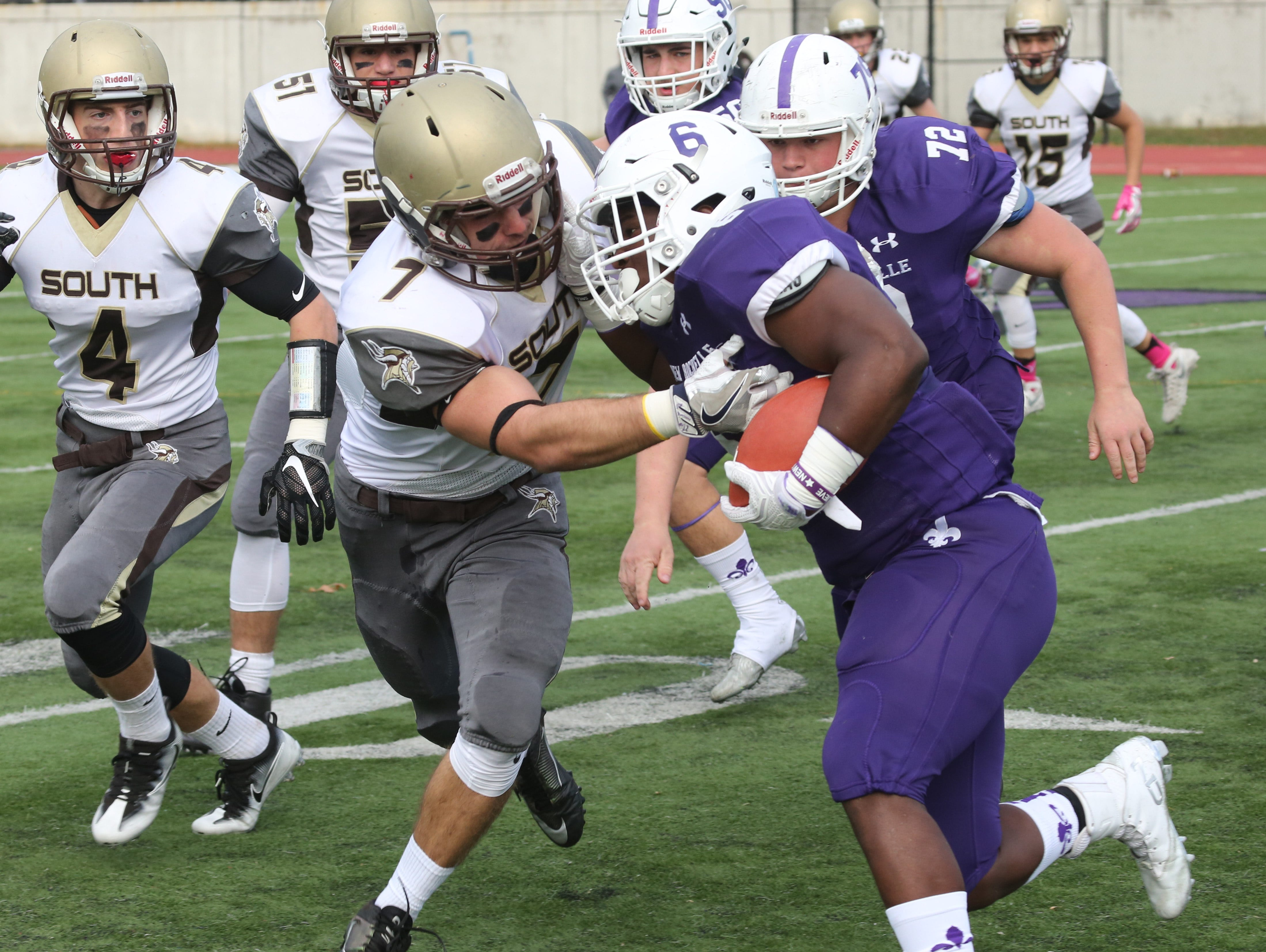 New Rochelle's Jared Baron is stopped by Clarkstown South's Samuel Mistretta during their Class AA semifinal in New Rochelle Oct. 29, 2016.