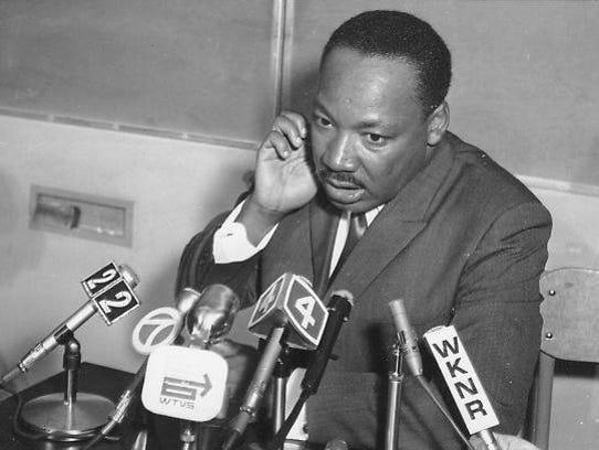 The Rev. Martin Luther King Jr. speaks at a press conference