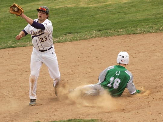 Clear Fork's Brad Johnson steals second base from Lexington's
