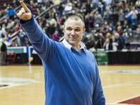 Northern Lebanon head coach Ken Battistelli points to the crowd after the Vikings won the PIAA District 3 4A championship, 46-44, over Bishop McDevitt at the Giant Center last Friday.