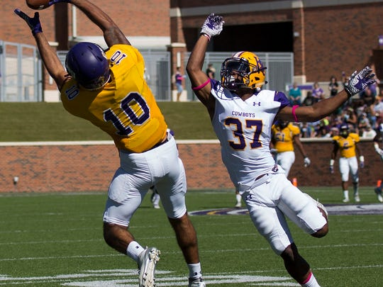 Mary Hardin-Baylor's T.J. Josey (10) makes a catch for 41 yards against Hardin-Simmons' Kylon Mills (37) during UMHB's 20-15 win Saturday, Oct. 22, 2016, at Crusader Stadium in Belton.