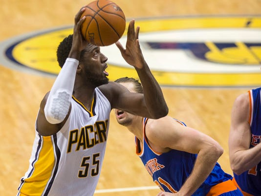 Indiana Pacer's center Roy Hibbert (55) puts up a shot from the baseline during the second half of an NBA basketball game, Thursday, Jan. 29, 2015, in Indianapolis. The Pacers defeated the Knicks 103-82. (AP Photo/Doug McSchooler)