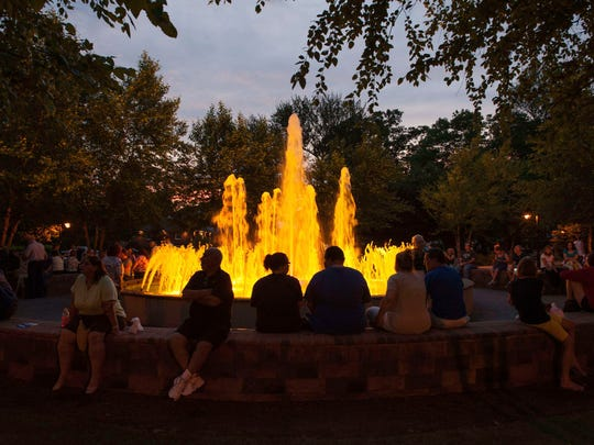 The fountain in the park lit up.