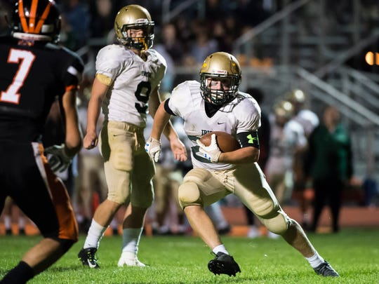York Catholic's Andrew Snelbaker runs the ball against Hanover on Friday, Sept. 29, 2017. The Fighting Irish defeated the Nighthawks 54-34.