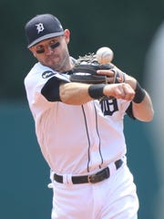 Ian Kinsler throws out the Giants' Joe Panik in the first inning of the Tigers' 6-2 win July 6, 2017 at Comerica Park.