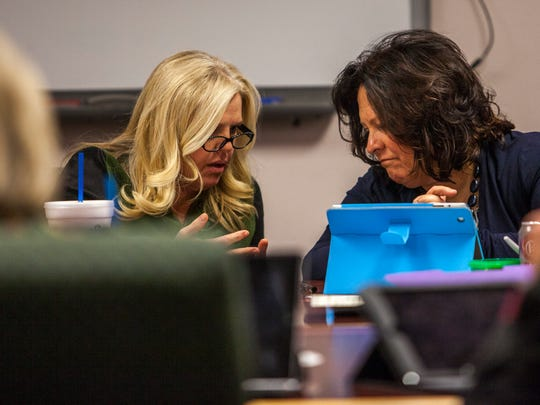 Iron County School Board President Michelle Jorgensen (left), speaks with Superintendent Shannon Dulaney, during the school board meeting Tuesday, Jan. 26, 2016.