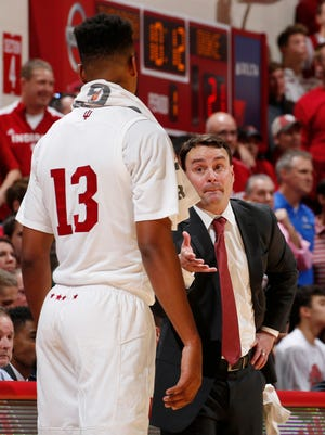 Hoosiers coach Archie Miller talks to forward Juwan Morgan (13) during the first half against the Duke Blue Devils at Assembly Hall.