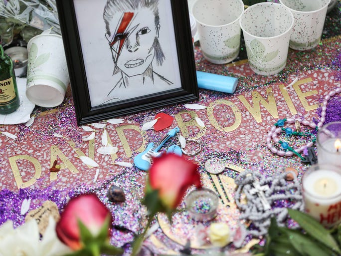 Flowers and other items are placed in remembrance of David Bowie at his star on the Hollywood Walk of Fame on Monday, Jan. 11, 2016, in Los Angeles.