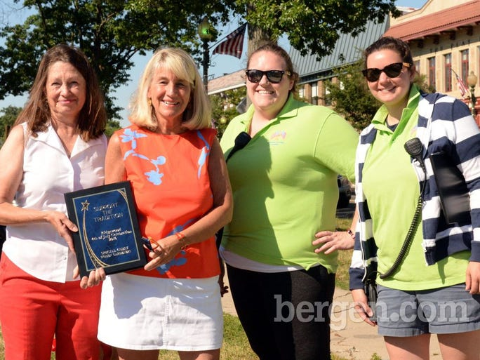 Woman Gardeners were presented with a special plaque by parade committee Tara Masterson (second from right) and Leigh Gilsenen
