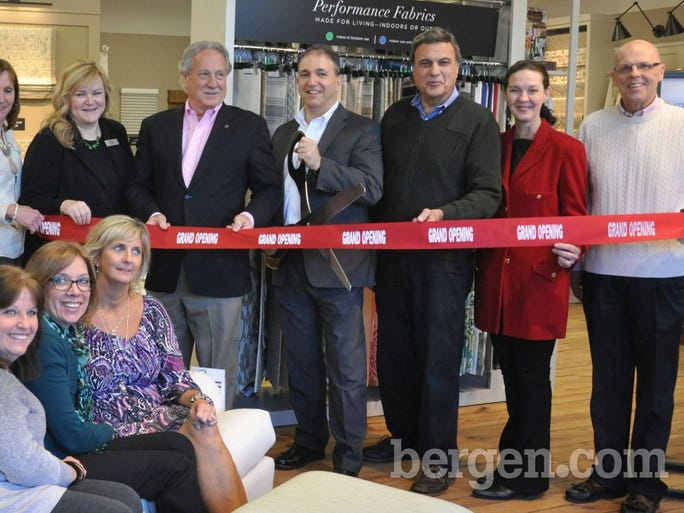 On hand for a ribbon cutting at Calico's new Ridgewood, NJ  store location were Regional Manager Donna Lanney, Store Manager Ilise Cohn, Calico CEO Bert Kerstetter, Ridgewood Mayor Paul Aronsohn, Deputy Mayor Albert Pucciarelli, Councilwoman Susan Knudsen and Ridgewood Chamber of Commerce Board of Directors Member Ed Sullivan.  Seated on the sofa are three Calico associates, Julie Forrest, Paula Feick and Patty Levine.