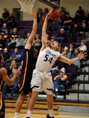 University of Sioux Falls' Devin Green rebounds the ball away from Northern State University's Carter Evans during their game at the Stewart Center on Friday.