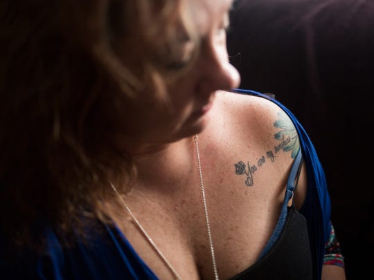 Tracey Williams of Liberty displays a tattoo saying,