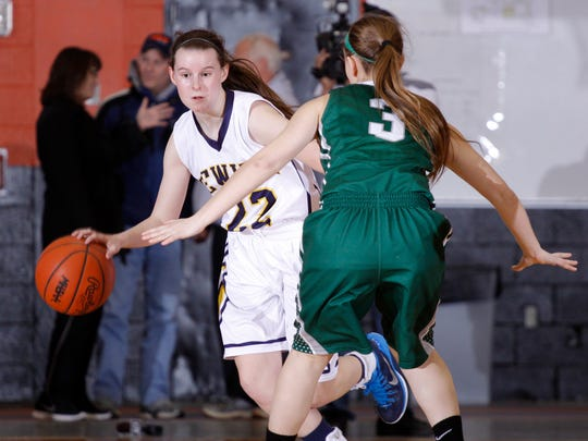 DeWitt's Shannon O'Connor, left, pushes the ball against
