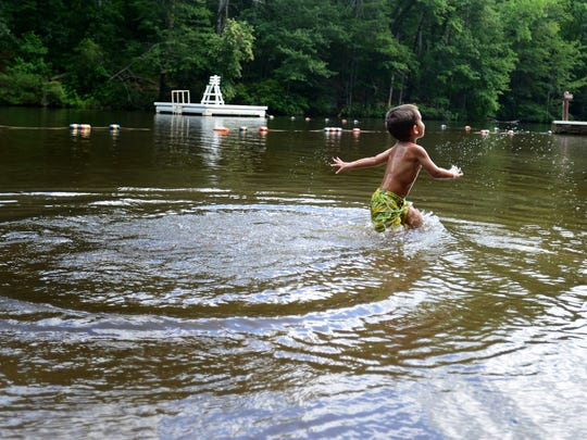 Bailey Apple, 3, plays in Lake Placid at Paris Mountain State Park  on Wednesday.