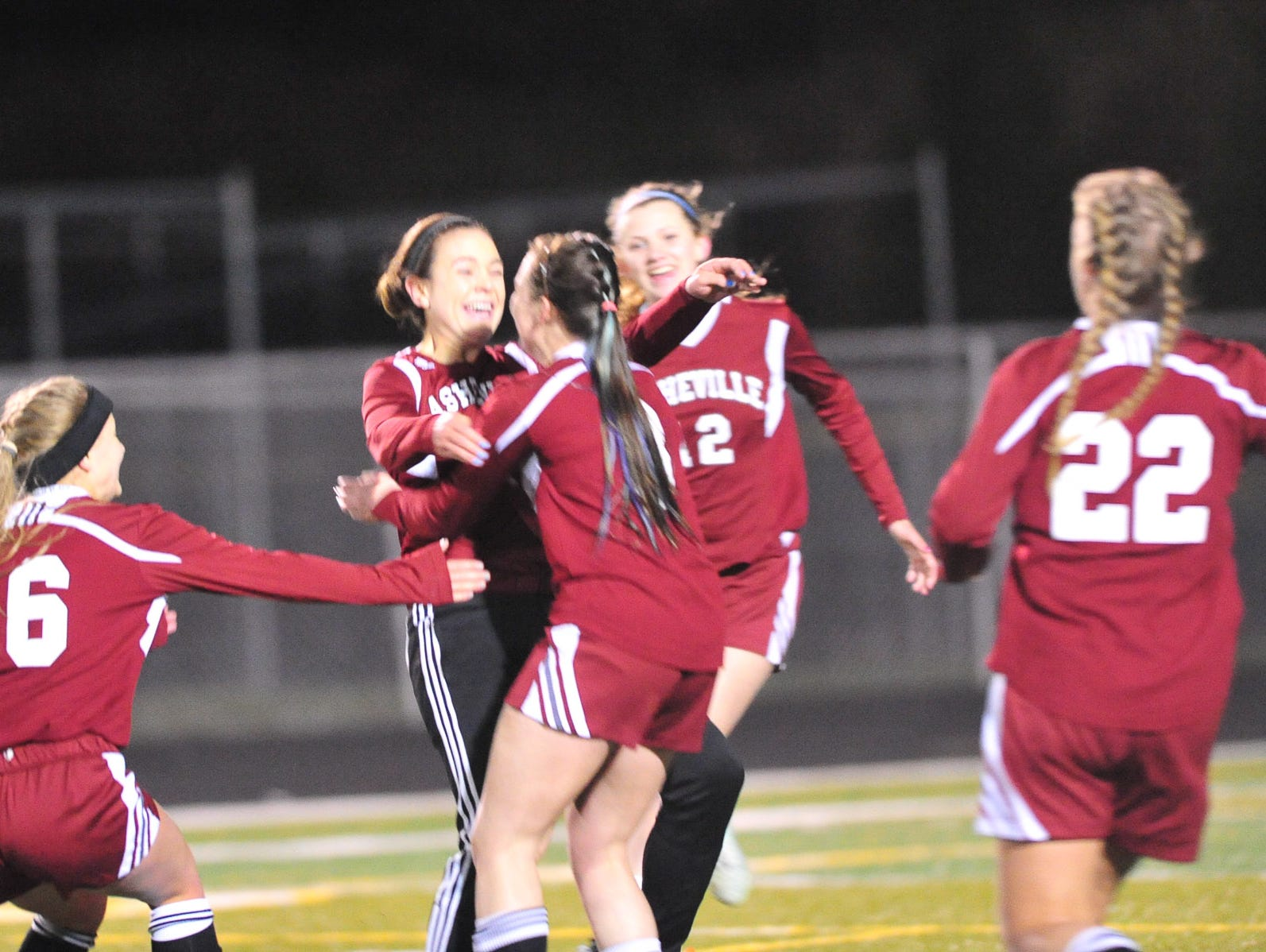 Teammates congratulate Asheville High's Sarah Sirkin after she scored a goal Monday night at Reynolds.