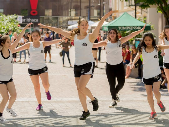 "The ""On Tap"" dance group from Cornell University performs Saturday afternoon at the CU Downtown event on The Commons."