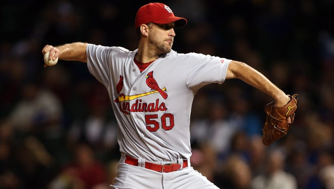 Cardinals starting pitcher Adam Wainwright throws a pitch against the Chicago Cubs during the second inning at Wrigley Field.