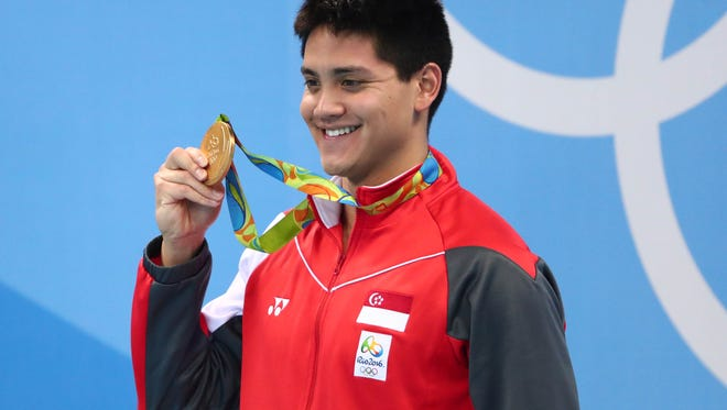 Singapore's Joseph Schooling scored a medal and cash in the 100-meter  butterfly at the Rio Olympics.