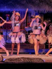 The Mana Hune dance group performs at Fish Eye Marine