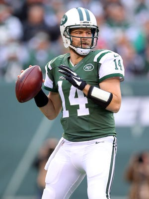 New York Jets quarterback Ryan Fitzpatrick drops back to pass against the New England Patriots on Sunday.