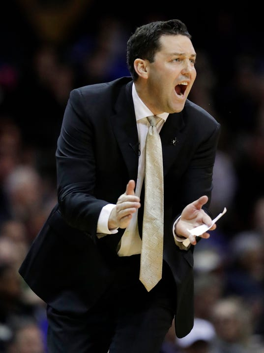 Vanderbilt head coach Bryce Drew yells in the first half of an NCAA college basketball game against Kentucky Saturday, Jan. 13, 2018, in Nashville, Tenn. (AP Photo/Mark Humphrey)