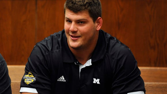 Tennessee Titans rookie NFL football player Taylor Lewan sits in Washtenaw County District Court in Ann Arbor, Mich., where he plead guilty to two misdemeanors to resolve an assualt case involving an Ohio State fan, Thursday, Oct. 30, 2014.