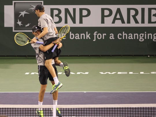 The Bryan brothers Mike and Bob celebrate their BNP Pribas Open men's doubles championship.