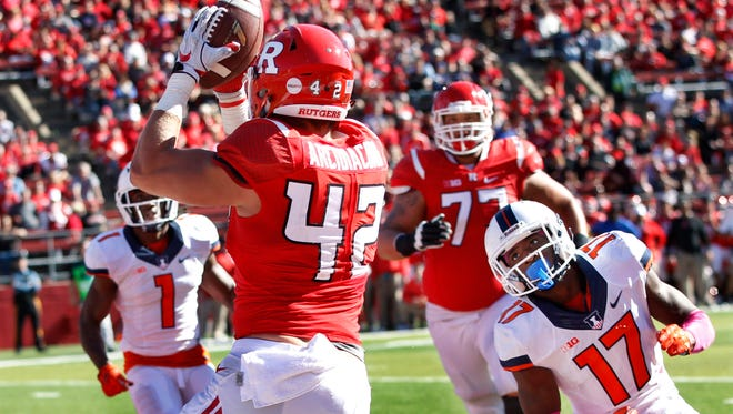 Rutgers tight end Nick Arcidiacono (42) catches a pass for a touchdown in front of Illinois defensive back Stanley Green (17) during the second half of an NCAA college football game Saturday, Oct. 15, 2016, in Piscataway, N.J. Illinois won 24-7. (AP Photo/Mel Evans)