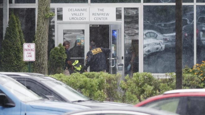 Officials respond to the scene where two people were shot at a Mount Laurel doctor's office on Friday, July 24, 2020.