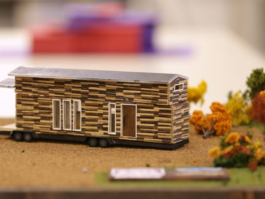 A model of a tiny house designed and built by a student