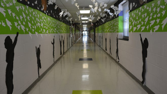 Students at Southern Delaware School of the Arts designed an interactive installation in a school hallway.