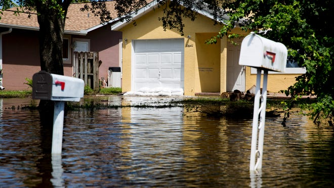 Floodwaters, while still high as a foot in some areas, finally began to recede northeast of the Imperial Parkway and Bonita Beach Road intersection in Bonita Springs as residents started to assess the damage left behind Thursday, August 31, 2017.