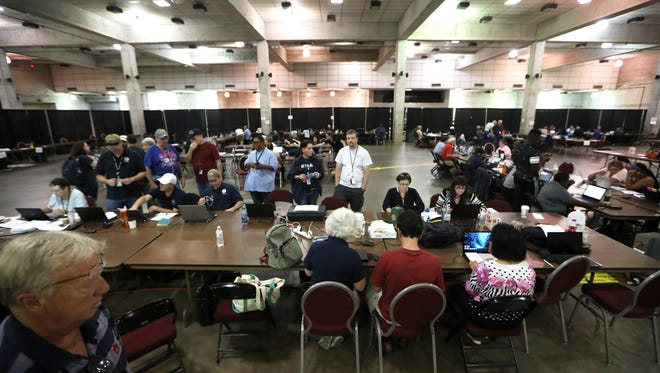 The Federal Emergency Management Agency works out of their remote office at the Civic Center, where more than a hundred full-time FEMA workers, reservists, and volunteers have come together to respond to disaster needs from Hurricane Irma.