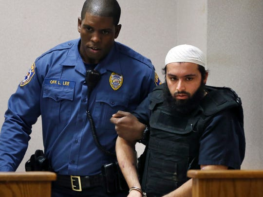 In this Dec. 20, 2016, file photo, Ahmad Khan Rahimi, the man accused of setting off bombs in New Jersey and New York in September, injuring more than 30 people, is led into court in Elizabeth. Rahimi is seeking to have attempted murder charges dropped for his shootout with police.