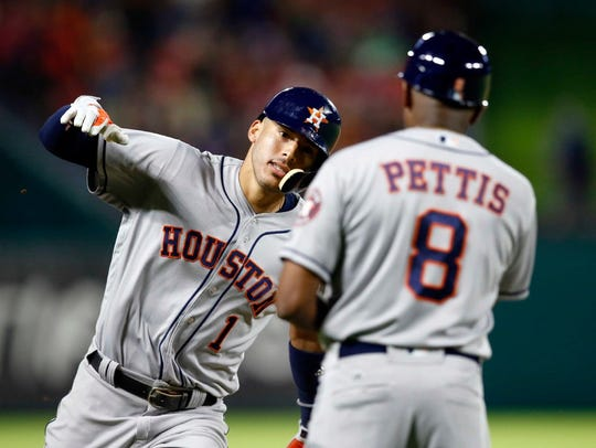Carlos Correa and the Houston Astros continued to pile