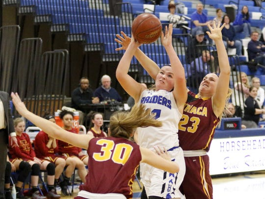Marissa Adams of Horseheads goes up for a shot in between