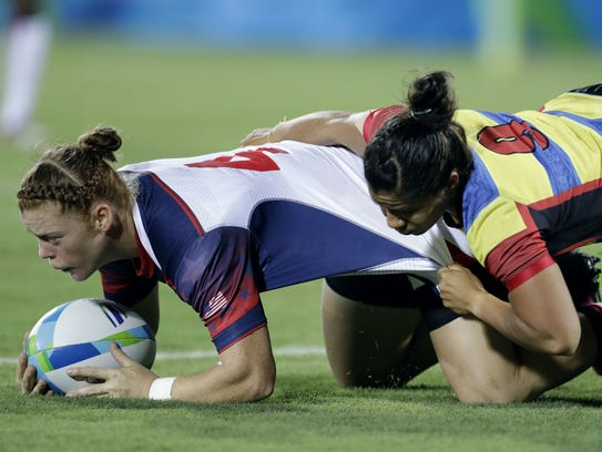 Alev Kelter (left) scores a try for the U.S. women's