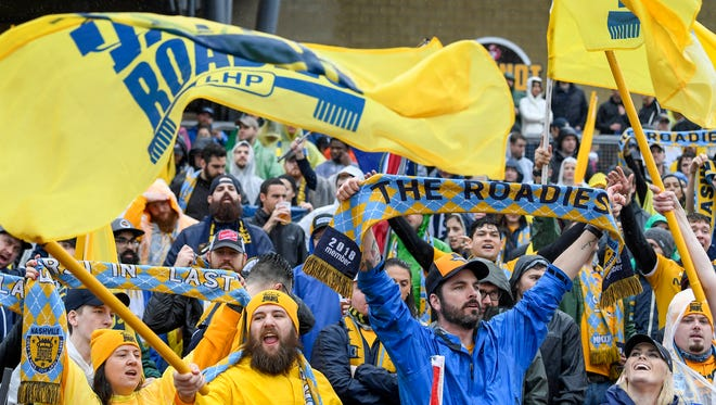 Nashville Roadies cheer as Nashville SC takes the field against Atlanta United FC during an exhibition game Saturday at First Tennessee Park.