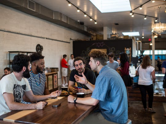 Customers converse at Reve Coffee Roasters in downtown Lafayette, La., Tuesday, Sept. 15, 2015. The business recently relocated to 200A Jefferson Street in downtown Lafayette