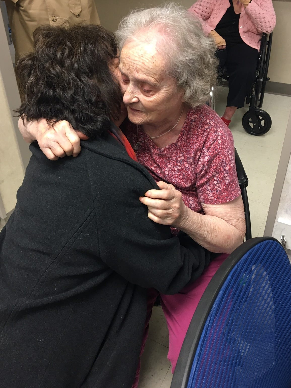 Britt Kennerly hugs her mother, Helen Harney, before leaving Kentucky to return to Florida in December 2017.