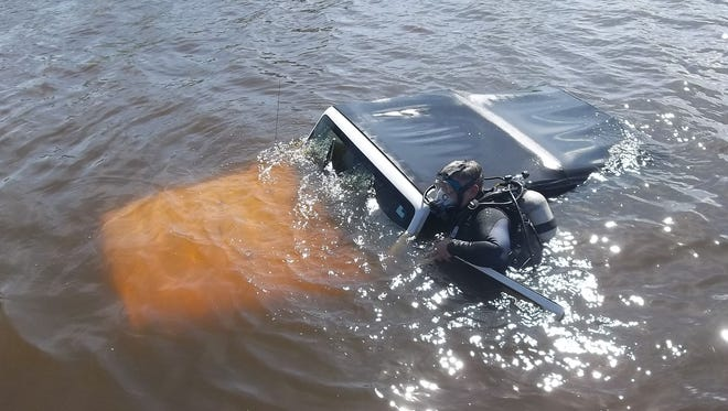 Dep. Fazio assists while Jeep is pulled from water.